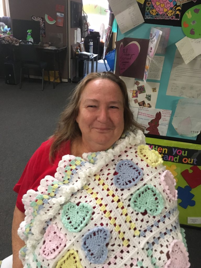 Ms. Jeannie showing off one of her handmade creations. We are impressed, Jeannie!
