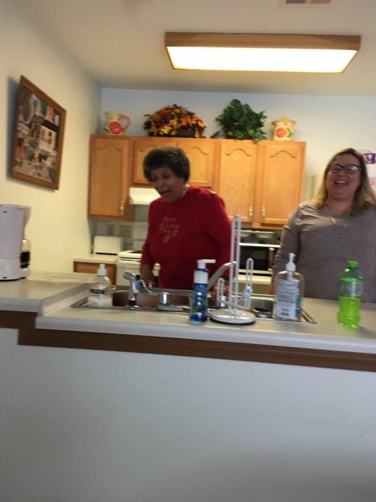 Denise washing dishes with Tiffany.